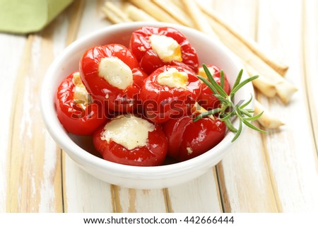 appetizer antipasti sweet peppers stuffed with soft cheese - stock photo