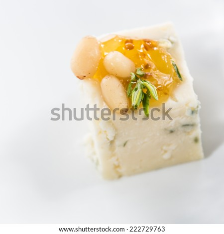 Appetizer. Blue cheese with nuts. Creative cuisine. close-up