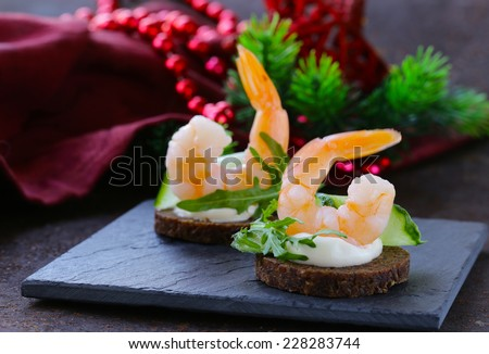 appetizer canape with fresh cucumber, arugula and shrimp - stock photo