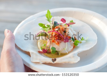 Appetizer ceviche with raw scallop and sauce - stock photo