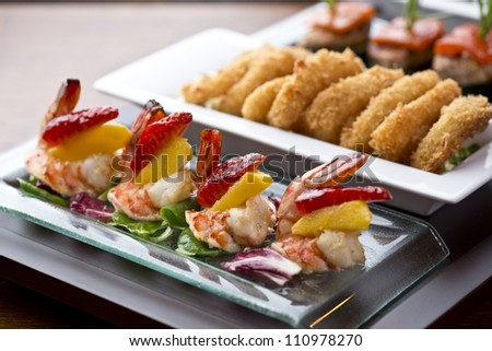 appetizer food or tapas / delicious side dish with shrimp, strawberry and mango - stock photo