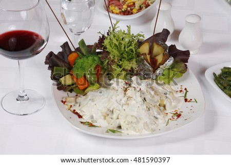 Appetizer foods with red wine on the restaurant table.