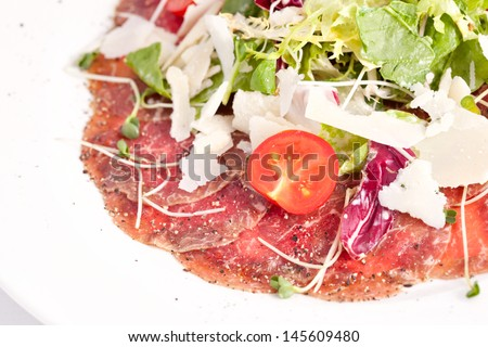 Appetizer - Meat Carpaccio with Parmesan Cheese - stock photo