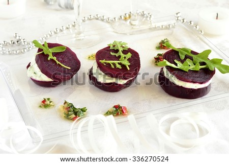 Appetizer of beet with goat cheese and sauce - stock photo