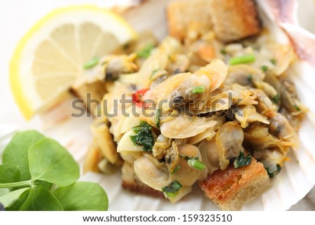 """appetizer of fried portuguese clams """"conquilhas""""  - stock photo"""