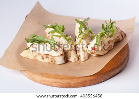 appetizer of pita bread and cheese - stock photo
