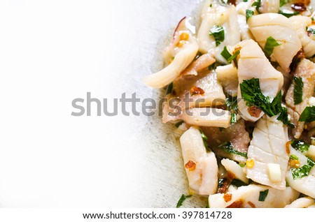 Appetizer of squid in a spicy marinade. Selective focus. - stock photo