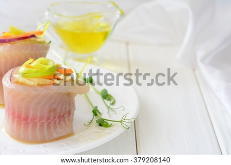 Appetizer of tilapia fish with vegetables on a white background - stock photo