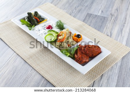 appetizer on white plate - stock photo
