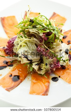Appetizer - Salmon Carpaccio with Salad Mix - stock photo