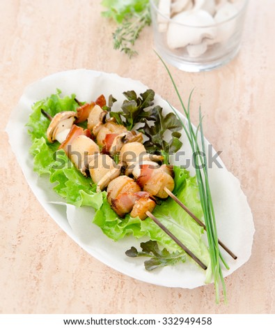 appetizer skewers scallop mushrooms vegetables bacon on skewers white plate - stock photo