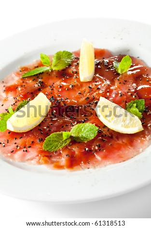 Appetizer - Tuna Carpaccio with Parmesan Cheese, Herbs and Lemon Slice