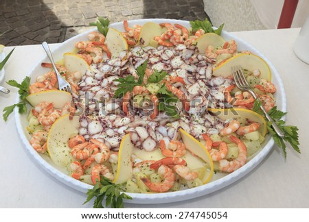 appetizer with octopus and prawns - stock photo