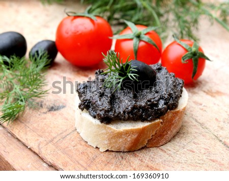 Appetizer with olive paste - stock photo