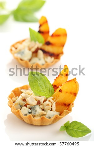 Appetizer with peaches, gorgonzola and almonds - stock photo