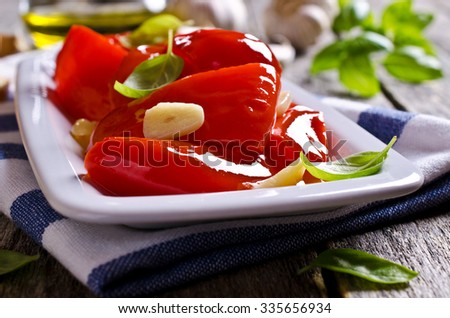 Appetizer with red pepper, garlic and Basil. Selective focus. - stock photo