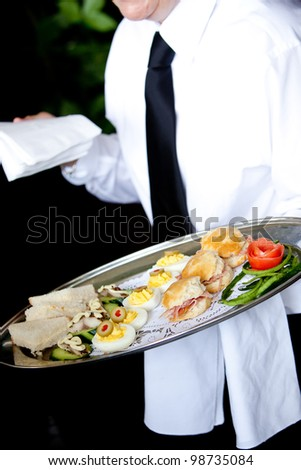 appetizers being served at a catered event of function on a platter - stock photo