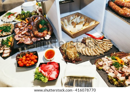 Appetizers on a black dishes served for a buffet - stock photo