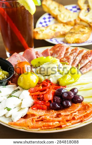 Appetizers plate with antipasto in Italian restaurant.