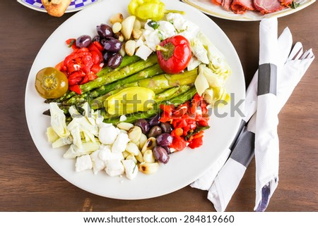 Appetizers plate with vegetarian antipasto in Italian restaurant.