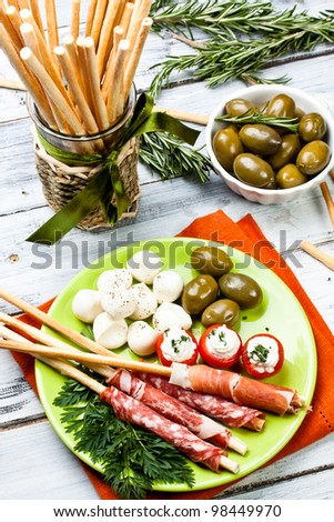 appetizers with salami,ham,tomato and olives - stock photo