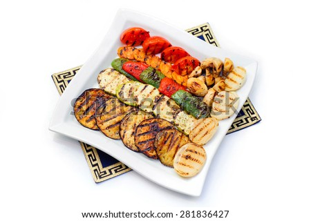 Appetizing assorted grilled vegetables on white plate