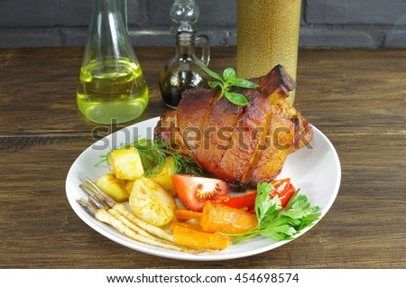 appetizing baked knuckles of pork on plate - stock photo
