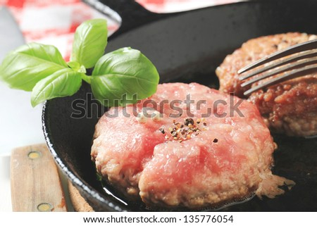 Appetizing burger in a frying pan