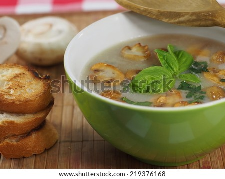 appetizing cream soup with champignon mushrooms