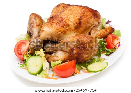 Appetizing crispy red roasted spicy grilled chicken with vegetable garnish on white plate on isolated white background - stock photo