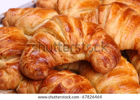 Appetizing croissants on a white background - stock photo