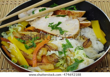 appetizing food with vegetables and rice noodles