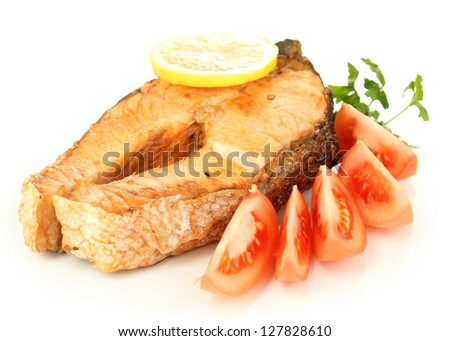 Appetizing grilled salmon with lemon and vegetables isolated on white - stock photo