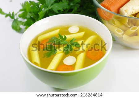 appetizing hot bullion with parsley - stock photo