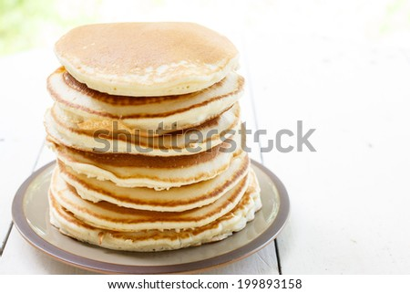 Appetizing pancakes on plate