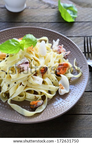 appetizing pasta with mussels and squid, food closeup - stock photo