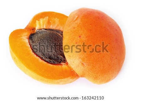 appetizing ripe orange apricot closeup macro over white background - stock photo