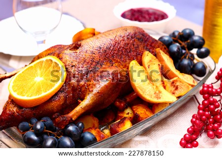 Appetizing roast duck with orange, served on a festive table, close up - stock photo