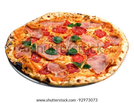 appetizing round pizza with ham, tomatoes and greens - stock photo