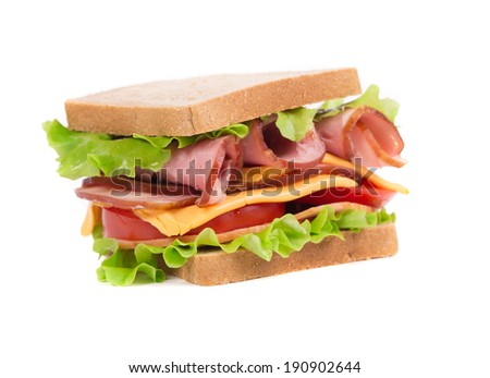 Appetizing sandwich with ham and cheese. Isolated on a white background. - stock photo