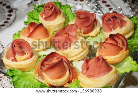 Appetizing sandwiches on party table - stock photo