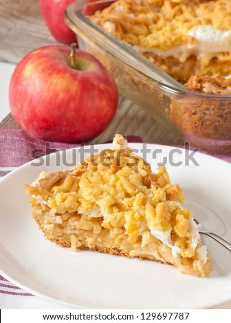 Appetizing slice of pie with apples and meringue layer