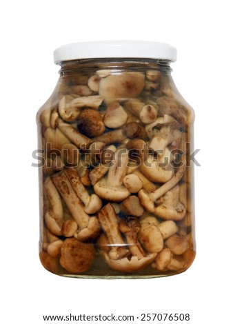 Appetizing tinned mushrooms in glass jar isolated on white background. - stock photo