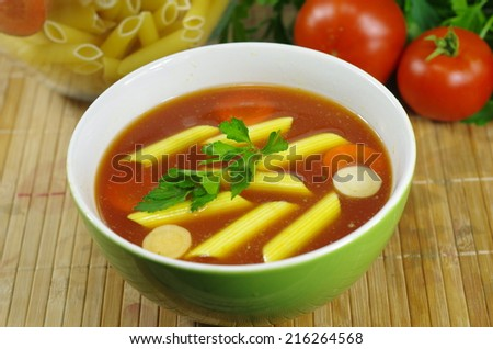 appetizing tomato soup with parsley and pasta - stock photo