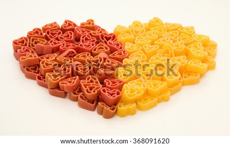 Appetizing Valentines pasta in shape of heart - stock photo