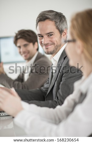 applause for a colleague in a meeting - stock photo