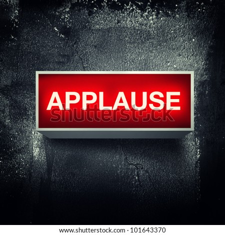Applause warning board message is lit on. - stock photo