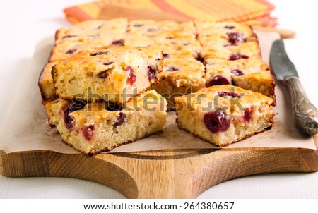 Apple and berry traybake slices on board