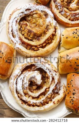 Apple and cinnamon rolls - stock photo