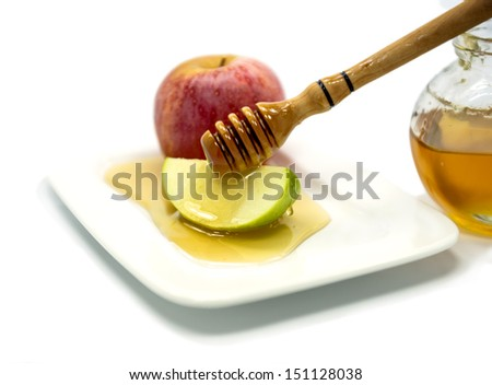 Apple and honey are traditional food for Rosh Hashanah - Jewish New Year - stock photo